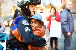 white cop with african american boy